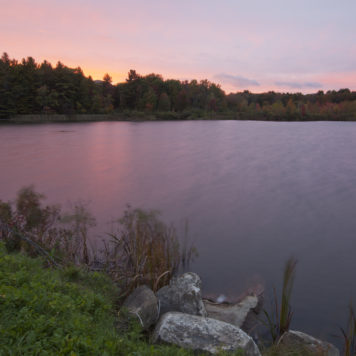 Twilight view of Pontoosuc Lake in Pittsfield, Massachusetts.