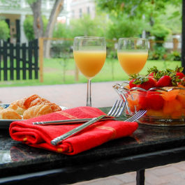 Enjoying a simple continental breakfast outdoors can be a favorite simple pleasure of travel. This kind of breakfast is often available at small inns, bed and breakfast's, and Air B and Bs.