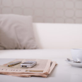 Newspaper and tea cup on table