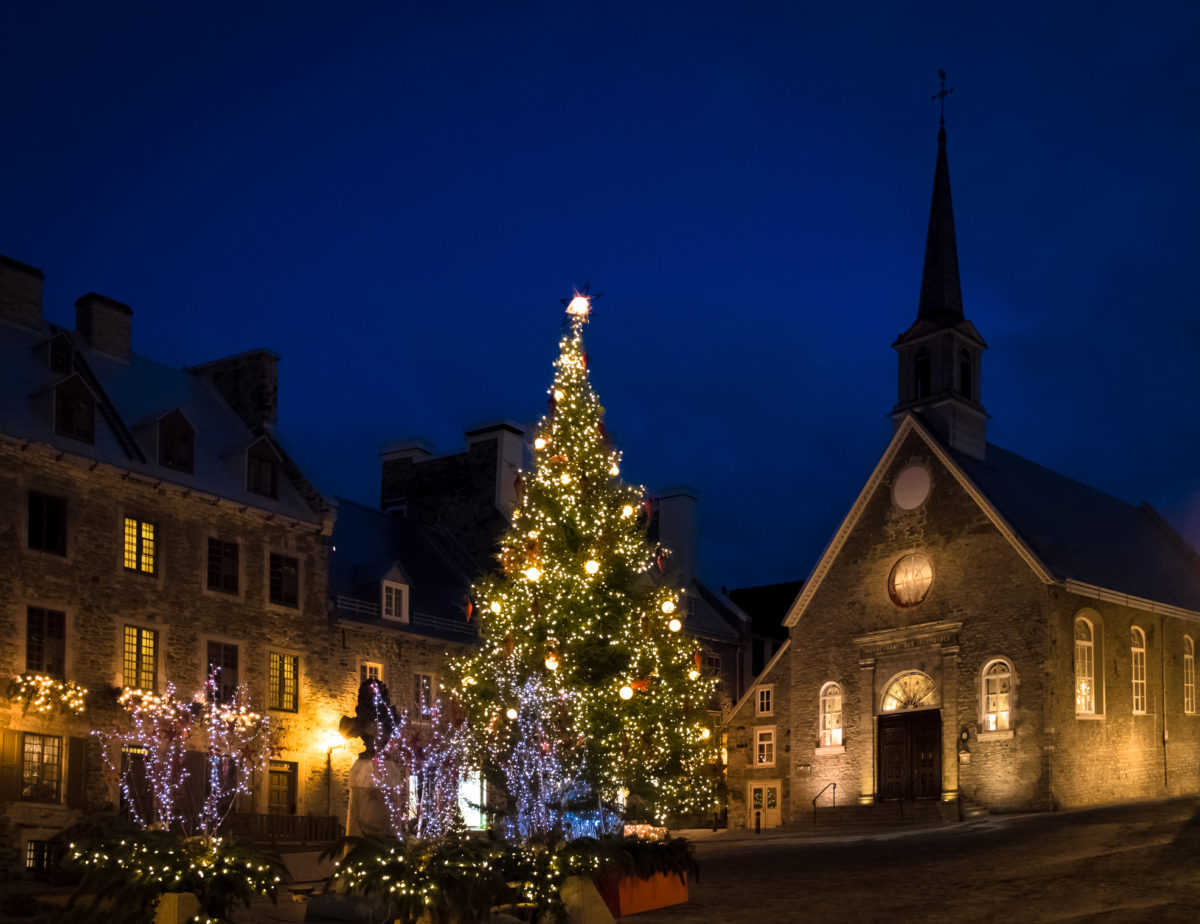Place Royale (Royal Plaza) and Notre Dame des Victories Church decorated for Christmas at night - Quebec City, Canada