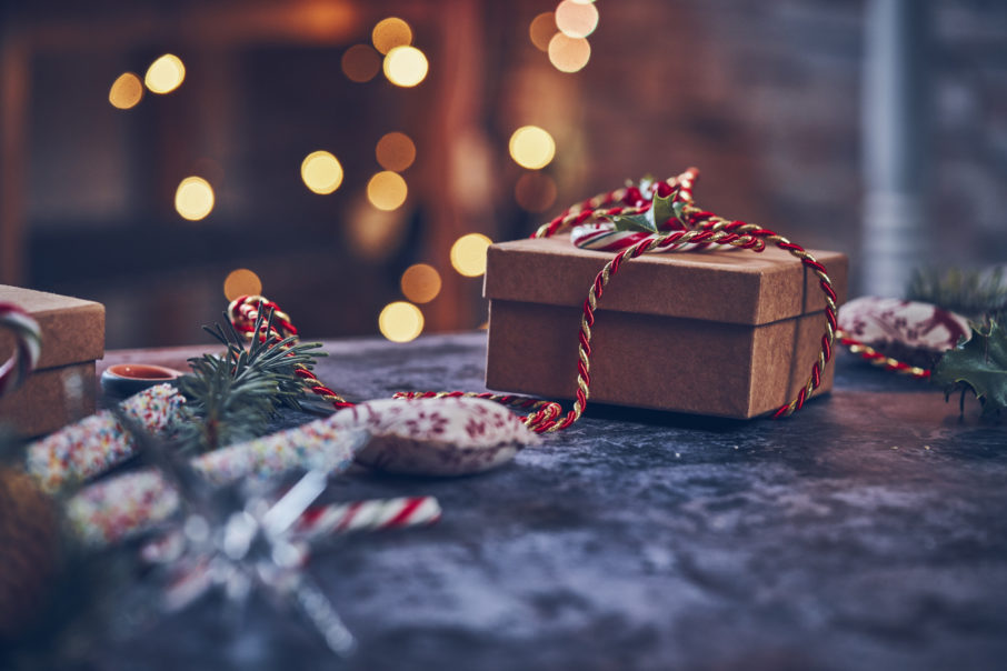 Wrapping and Decorating Christmas Presents in a Cosy Atmosphere at Home.