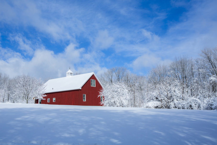 A red barn after a snow storm
