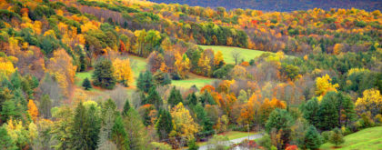 Autumn foliage in the Bershire Hills region of Massachusetts. Photo taken from a scenic viewpoint of the Mount Greylock Range during the peak fall foliage season. The Berkshires region enjoys a vibrant tourism industry based on music, arts, and recreation.