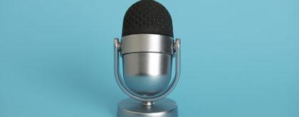 Microphone on blue background.